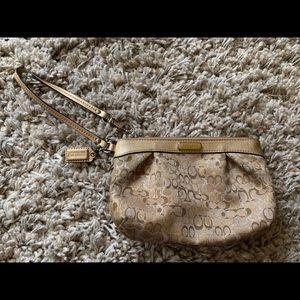 COACH gold wristlet